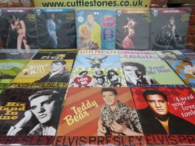 """A COLLECTION OF ELEVEN ELVIS PRESLEY LP RECORDS BY DOM DISQUES, together with a selection of 12"""" ma"""
