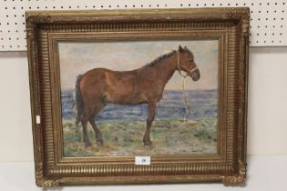 L.K.W. (XX). An impressionist beach scene with horse. signed with initials lower right, oil on