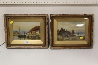 A PAIR OF ANTIQUE GILT FRAMED OILS ON BOARDS DEPICTING HARBOUR SCENES WITH FIGURES INITIALLED