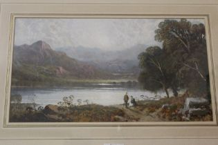 A FRAMED AND GLAZED OIL OF A MOUNTAINOUS LAKE SCENE, OVERALL HEIGHT 38 CM