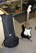 A STARCASTER GUITAR AND STAND