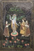 A FRAMED AND GLAZED SUB CONTINENTAL SCENE OF PEOPLE ATTENDING A DEITY, OVERALL HEIGHT 67 CM
