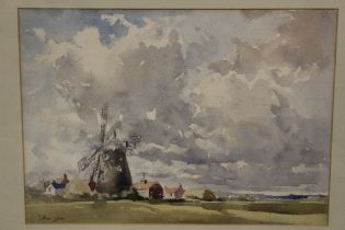 A FRAMED AND GLAZED WATERCOLOUR OF A NORFOLK WINDMILL BY ANN YATES, SIGNED LOWER LEFT, OVERALL