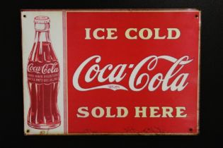 A FRAMED REPRODUCTION ENAMEL COCA-COLA PLAQUE, OVERALL HEIGHT 58 CM