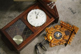 A BOX OF PRINTS, FRAMES AND CLOCKS TO INCLUDE A MODERN CUCKOO CLOCK, REPRODUCTION WALL CLOCK ETC.