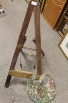 A VINTAGE WOODEN ARTISTS EASEL AND PALETTE (2)
