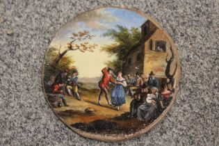 A SMALL 19TH CENTURY CIRCULAR OIL ON BOARD OF A VILLAGE SCENE WITH FIGURES BEFORE AN INN DIA-10CM