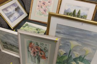 A COLLECTION OF FRAMED AND GLAZED WATERCOLOURS DEPICTING LANDSCAPES AND FLORAL STILL LIFE STUDIES,