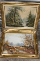 TWO GILT FRAMED OIL ON CANVASES DEPICTING LANDSCAPES ONE WITH DEER, BOTH INDISTINCTLY SIGNED