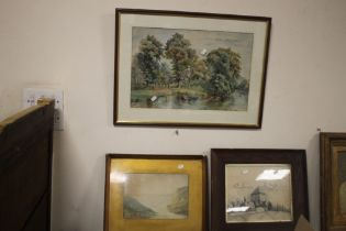 A FRAMED AND GLAZED WATERCOLOUR OF A RIVER SCENE TOGETHER WITH A PEN AND INK DRAWING OF A