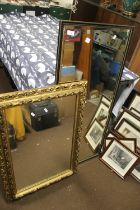A GILT FRAMED MIRROR TOGETHER WITH ANOTHER, THE LARGEST 46 CM X 21.5 CM