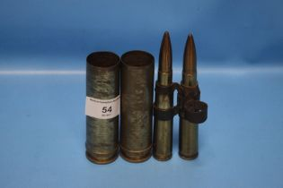 A PAIR OF WWII SHELL CASES AND BULLETS, one stamped 551 CY 79 PRAC 4* Z, the other 70 CY 80 PRAC 4