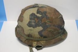 AN AMERICAN MI HELMET WITH LINER AND CAMO COVER, NO MAKER'S MARKS
