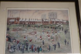 A FRAMED AND GLAZED PICTURE DEPICTING A FOOTBALL MATCH SIGNED B MCMULLEN