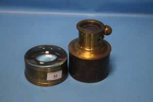 AN ANTIQUE BRASS MAGIC LANTERN LENS TOGETHER WITH ANOTHER (2)