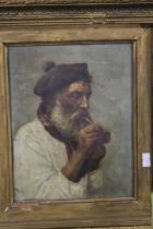 A FRAMED OIL ON CANVAS DEPICTING AN ELDERLY GENTLEMAN PUFFING ON HIS PIPE