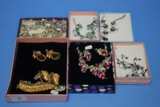 A QUANTITY OF BOXED COSTUME JEWELLERY