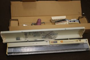 A BROTHER KNITTING MACHINE AND ACCESSORIES