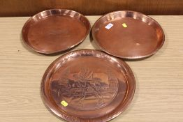 A VINTAGE COPPER JOHNNY WALKER WHISKEY TRAY TOGETHER WITH TWO ANSELLS EXAMPLES (3)