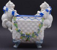 Porzellan Vase mit vollplastischen Katzen,im Boden blaumarke,ein Ohr und Blüten mit Abplatzer,H-