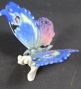 Schmetterling, ENS, Pressmarke 15, H. 7 cm, Flügel-L.: 9 cm, Teil der Basis abgebrochen