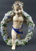 Porzellanfigur, Knabe mit Blumenkranz, KVE-Marke, H. ca. 20,5 cm, Körper weist Flecken auf