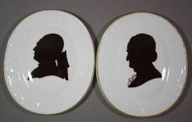 2x ovaler Wandschmuck, Meissen Schwertermarke, Silhouetten-Malerei, Goethe und Lessing, je 1.