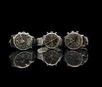 Three black dial chronograph gentleman's wristwatches.