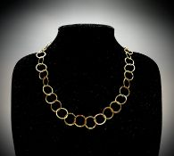 A contemporary, artist made 18ct gold hammered hoop necklace, hallmarked London 2005, makers mark