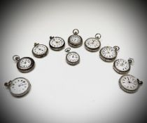 Ten silver cased keyless fob watches each with an ornamental dial and each with engraved decoration.