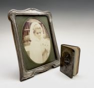 A silver-mounted George V photograph frame by S Lesser & Sons Ltd Birmingham 1927 23x17.5cm and an