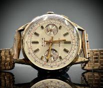 An Avia 9ct gold cased chronograph wristwatch 36mm diameter 52.8gm including gilt bracelet.