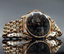 An 18ct gold cased Egona chronographe black dial wristwatch diameter 37.5mm 64.7gm including gilt