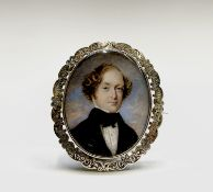 A Victorian chased gold memoriam brooch set with a portrait of a gentleman to verso a hair panel 4.