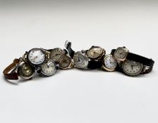 Four ladies gold cased wristwatches, two jewelled gilt cased watches and another gilt cased watch,