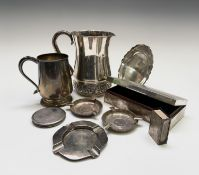 A collection of Indian silver comprising a repouse pitcher 473gm, a pint mug (inscribed) 347gm, a