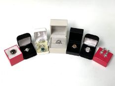 A silver Fiorelli ring, boxed, together with various other paste set costume jewellery rings, mostly