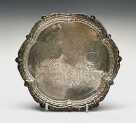 A Victorian silver lobed tray by Charles Boyton (II) with ornate borders, the centre engraved with