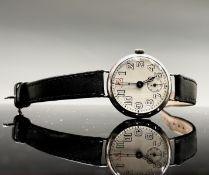 A silver trench wristwatch 32.7mm diameter London 1915 29gm with strap.
