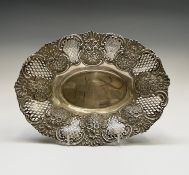 A Victorian silver oval fruit basket with floral panels within 'C' scrolls and beneath shells,