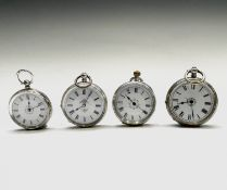Four silver open face small pocket watches, each with an enamel band on white. Three have a key wind