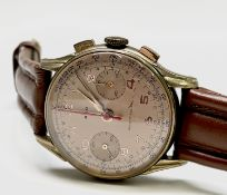 An Ado gold plated chronograph wristwatch Diameter 35.1mm 40.8gm including strap.