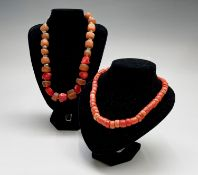 A coral and resin necklace with silver fitting and beads 145.3gm together with a coral necklace