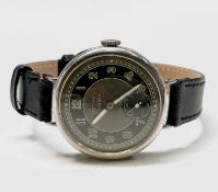 A silver Damas Degoumois trench cased wristwatch with black and khaki dial' hallmarked Bimingham