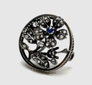 A late Victorian gold flower brooch, silver set with diamonds and a sapphire 27mm diameter 6.8gm