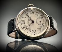 A Waltham silver trench cased wristwatch the screw-on back inscribed on the outside, S G MacLennan
