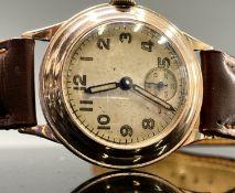 A 9ct gold cased wristwatch hallmarked Edinburgh 1939 30.6mm 25.8gm with strap. Phillip Wadsworth.