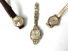 A 9ct gold cased ladies Omega wristwatch and two gold plated watches, one Omega the other Tissot