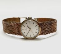 An Omega 9ct gold ladies wristwatch with 630 cal. movement no.25173255 with 9ct integral woven strap