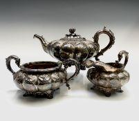 A George IV ornate three-piece silver tea service by Rebecca Emes & Edward Barnard I of melon fluted
